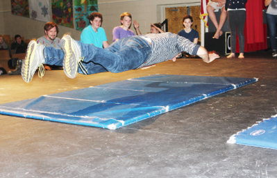 Physical comedy coach works with fall play cast