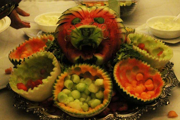 The culinary arts class provides a fruit plate garnished with Lion spirit.