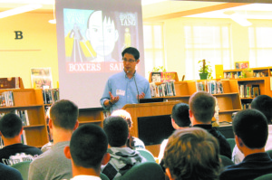 Graphic novel artist Gene Yang visits with comic book fans in the Akins High School library on Sept. 25, 2013. Along with being an artist, he's also a computer science teacher in California.
