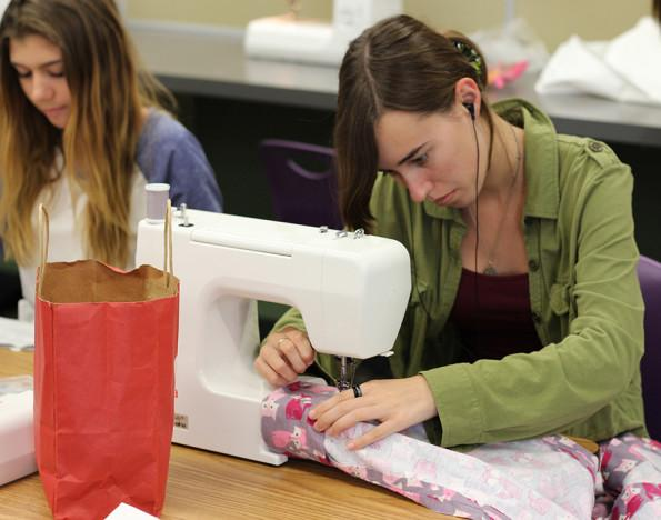 Fashion student Natalie Forbess goes to work on her sewing machine. These fashion students work hard in the chance of gaining a scholarship to college.