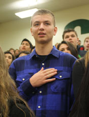 Brandon DuBois, junior, stands for the Pledge of Allegiance at the Veteran's Day assembly. DuBois is completely deaf in one ear and feels that he is treated well at Kentridge High.