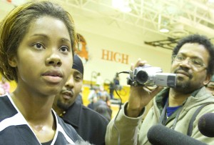 Tayler Hill is swamped by the press after a game during her senior year at South in 2009. Hill now plays in the WNBA.