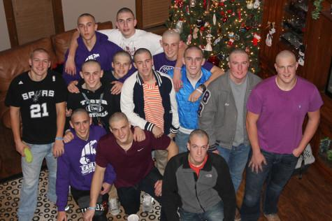 Coach's battle with cancer inspires boys to go bald
