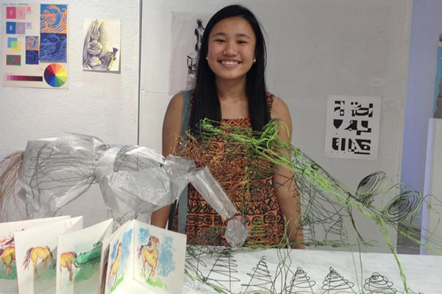 Nancy Ai of Diamond Bar High School in California displays some of her design projects.