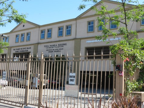 Yeshivah Gedolah covers Sterling's name on its sports pavilion