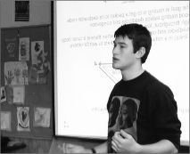Lukas Schwab speaks at a SPARKS lecture on May 5 about computer programming.