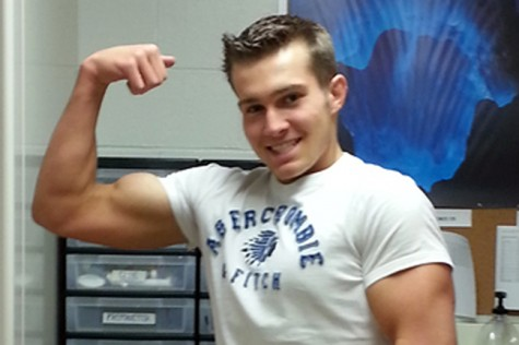 Junior Mike Cohen poses to show off his hard-earned muscles.