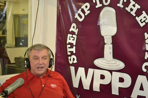"VERBALIZE — In the WPPA radio station, Mr. John Powers, former dean, speaks his opinion on the call-in radio talk show ""Step Up to the Mic."" He has been on the show for almost two years as a co-host/commentator. ""We hope that when the callers call in, they will take us in a certain direction, and we'll talk about that,"" Mr. Powers said. ""Otherwise, we have to throw the topics out there."""