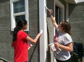 At Habitat house, a day of sun, sweat and spackle