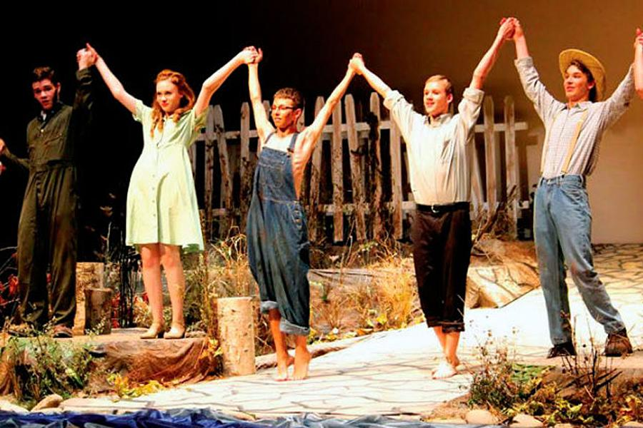 The cast of the Diviners accepts a standing ovation at curtain call.