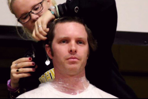 Heads shorn as part of fundraiser for Director of Enrollment