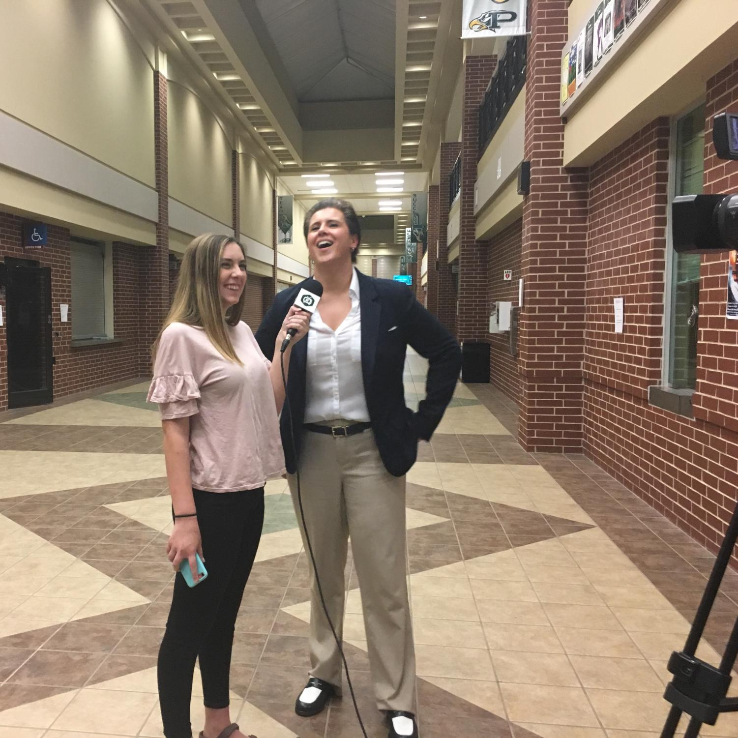 """ENN reporter Haylee Brown interviews democratic candidate Lorie Burch after the Town Hall Forum. Burch answered student-written questions during the forum and had a table set up outside the auditorium before and after for questions. """"When I was a student at Plano Senior High in AP history class and in government, I never imagined that one day I would aspire to be a part of that,"""" Burch said. """"But my teachers really inspired me to get involved in advocacy and leadership."""""""