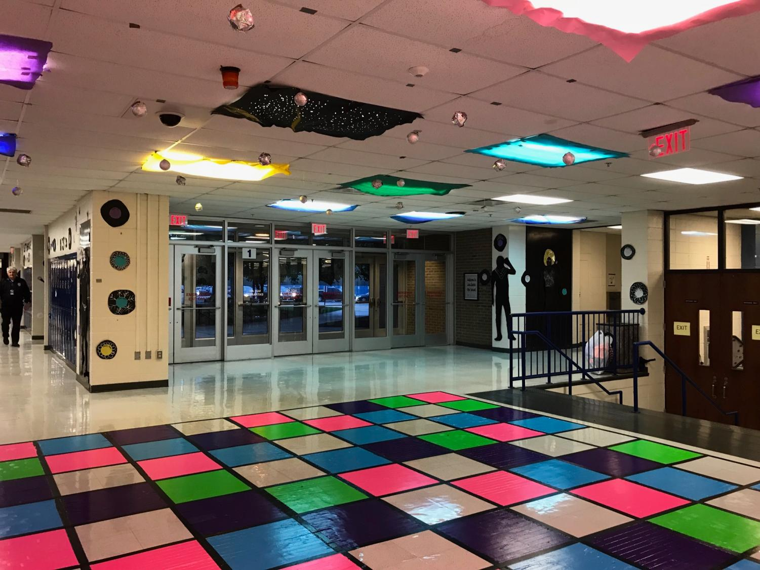 NHS's disco decorations are by the library entrance. The bright, checkered floor was hard to miss.