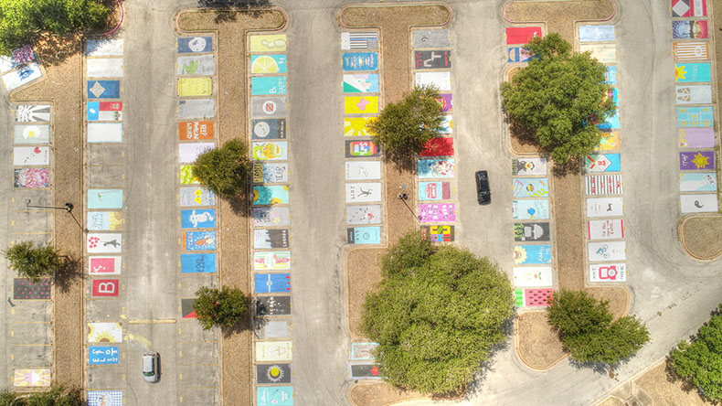 Painted parking spots stir up debate about criteria