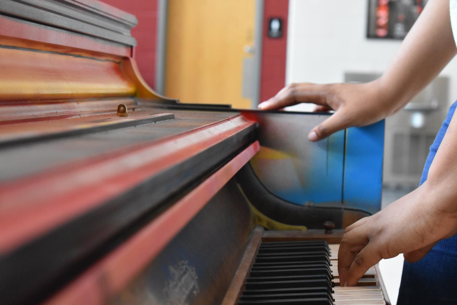 Finished Product: Students enjoy playing the newly finished piano during school hours, including lunch.