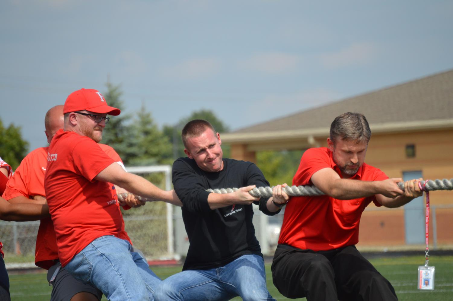 Assistant principal Kyle Goodwin, who was an English teacher at the time, fights to win the classic tug-of-war against his colleagues in the 2016 Homecoming Pep Rally.