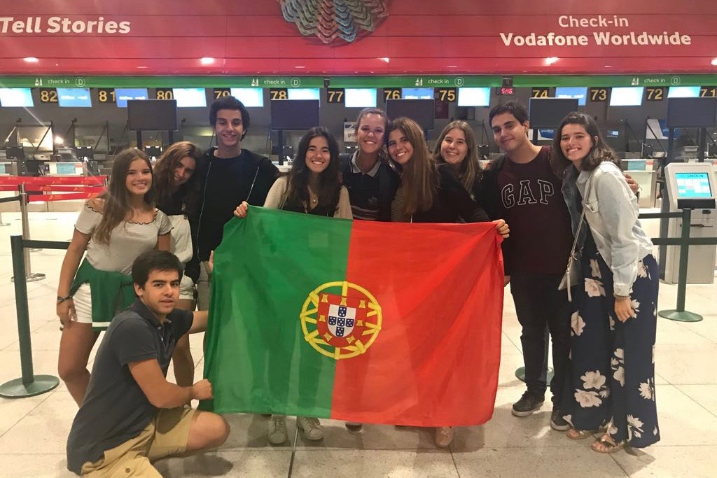 "Portuguese senior exchange student Ines Alpendre waits with her friends at the airport in her home country. ""Meeting new people makes me not miss my friends that much,"" Alpendre said."