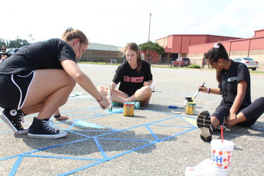 Seniors create parking lot masterpieces
