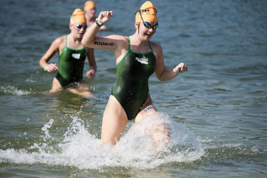 Cate Mulqueen, '20, splashes her way to the finish line of the half-mile course.