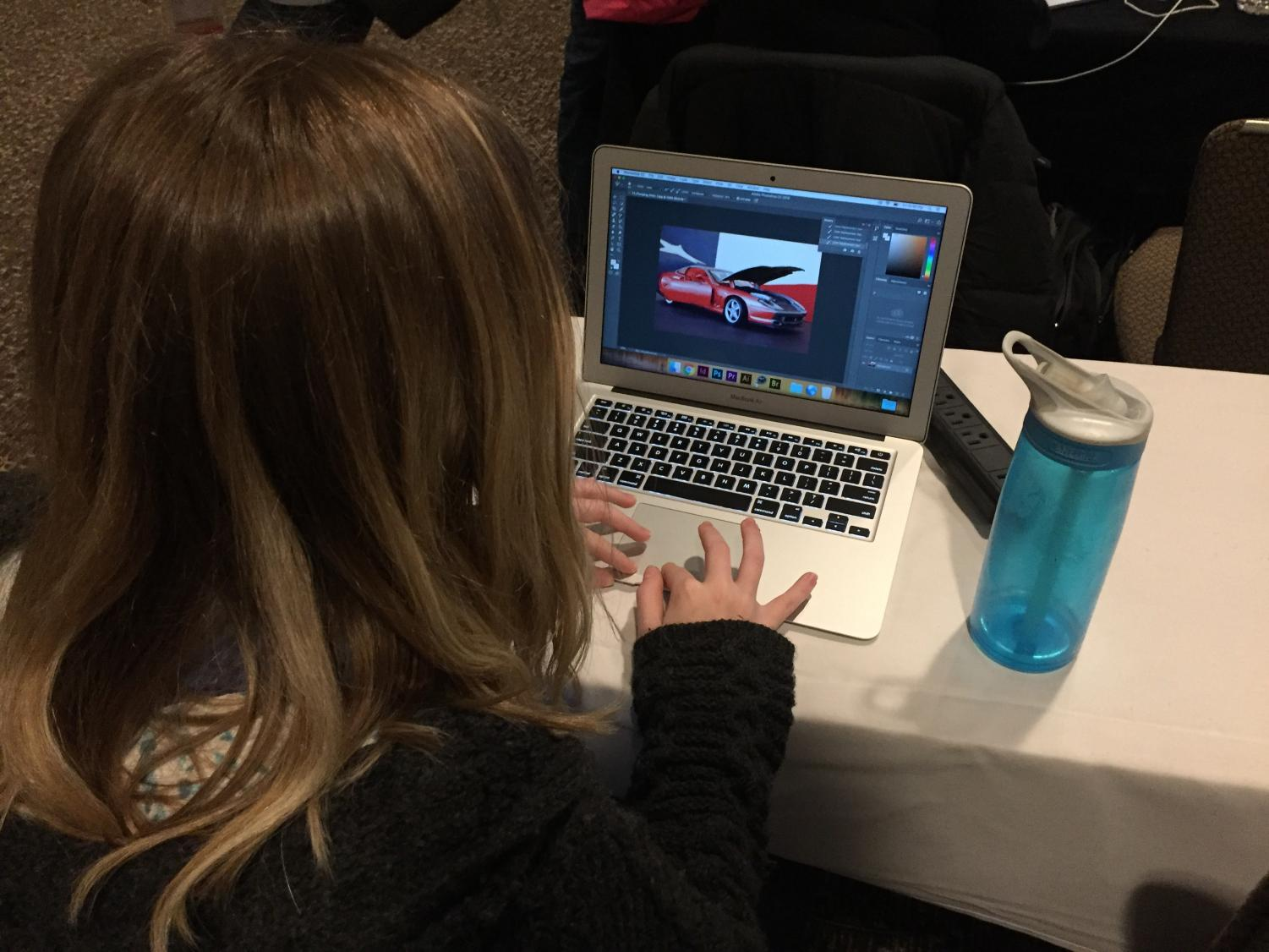 One girl learns to use photoshop and other programs in a computer design course. Girls are showing more interest in STEM fields as a result of classes like the girl's engineering day.