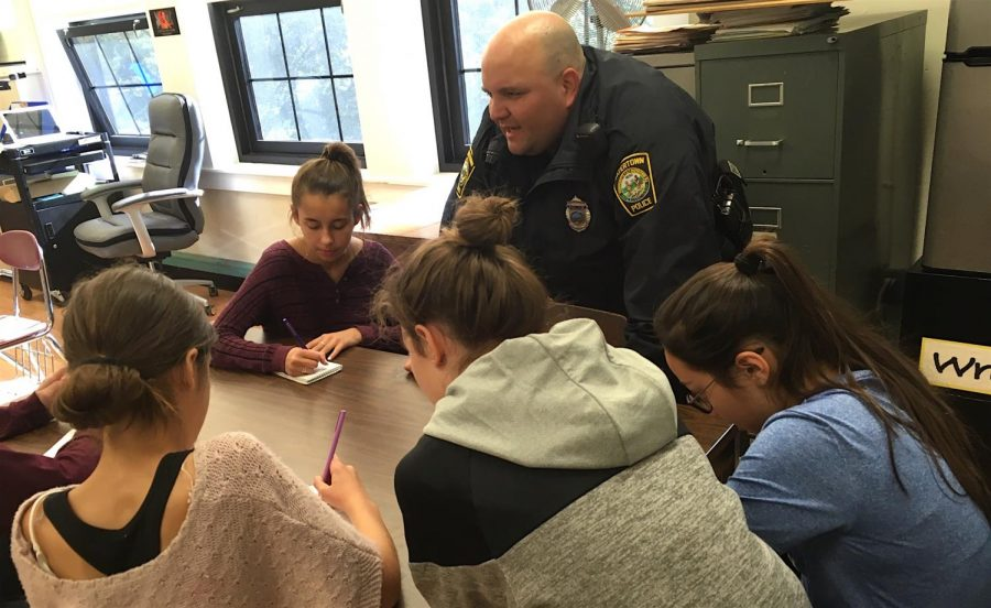 Officer+Miguel+Colon+of+the+Watertown+Police+Department+talks+about+the+recent+ALICE+training+at+Watertown+Middle+School+with+reporters+from+the+Watertown+Splash.+