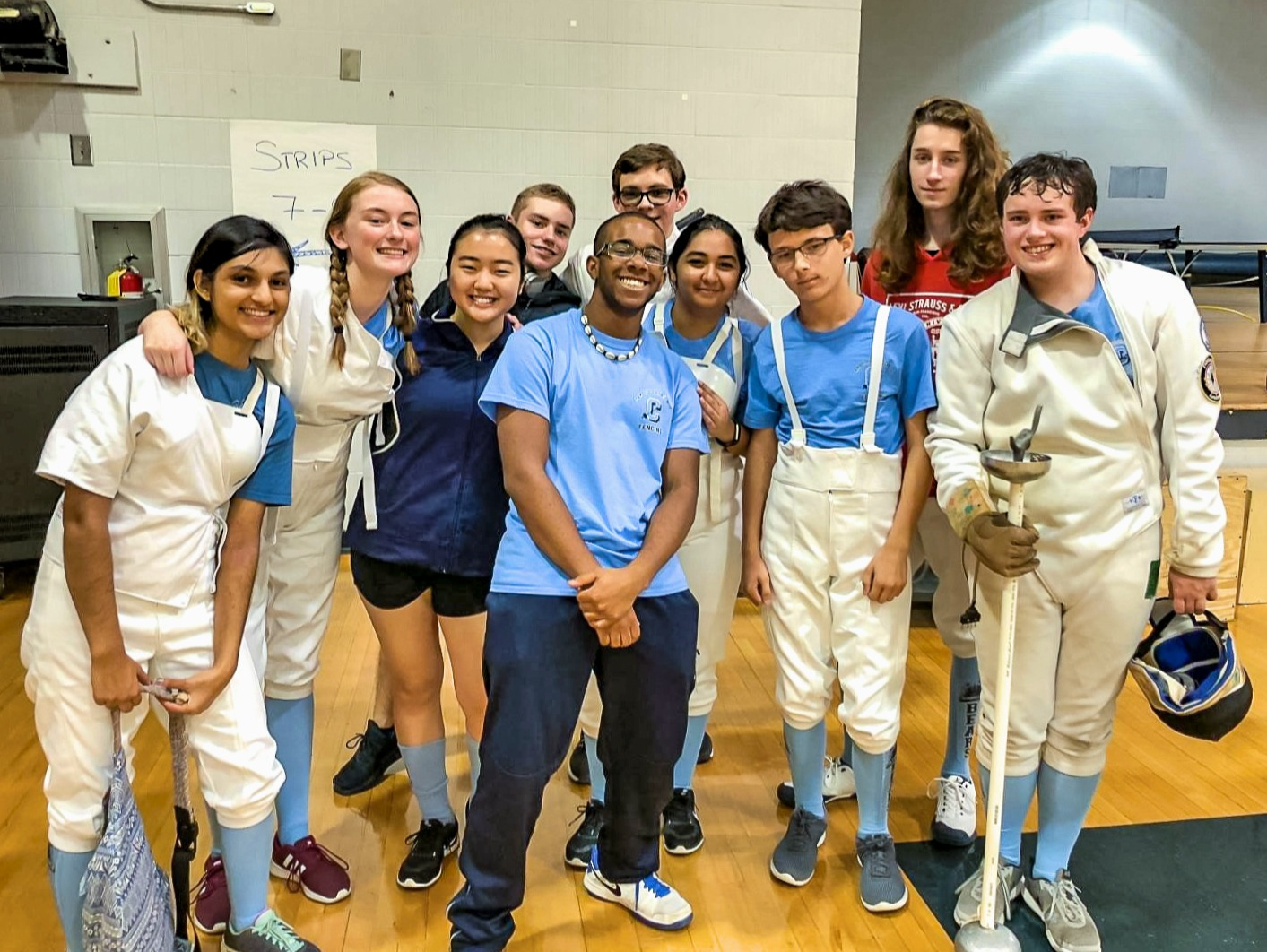 Members of the Cambridge fencing team at the Dunwoody High School tournament.