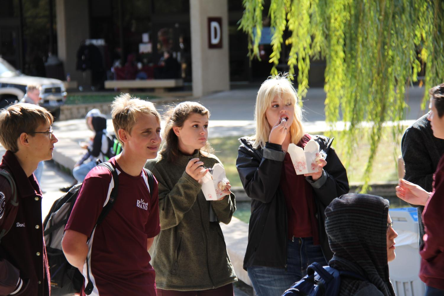 Juniors Bryan St. John, Kasi Schiffer and Mary Campbell enjoy watching one of the performances while eating Chinese food during the spring Stay Day last year. (photo by Ashley Brockette)