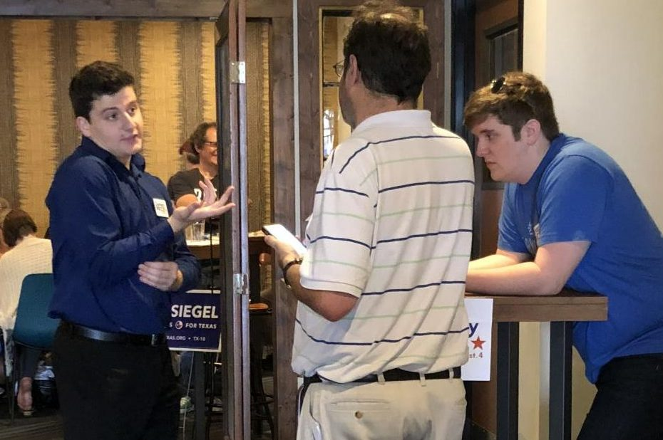 School board candidate Zachary Price meets with community members at his Brewtorium campaign event.