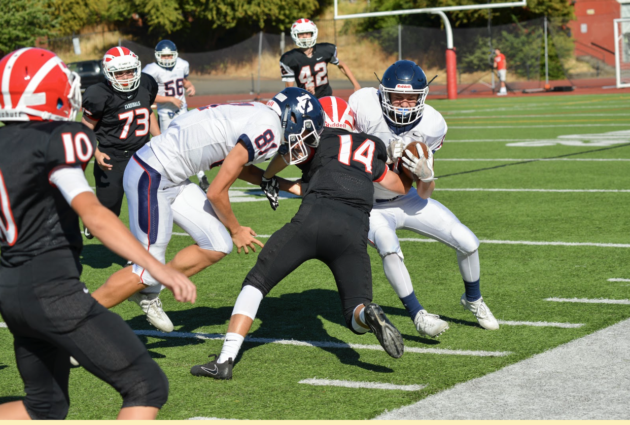 Football players collide during a September game. Concussions are a huge problem in high school sports, with around 300,000 high school related concussions occurring each year in the United States.