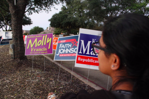 Staff writer Anika Arutla talks about the history of voting and her excitement about voting. Political signs are lined along the road to Coppell Town Center for upcoming midterm election on Nov. 9.