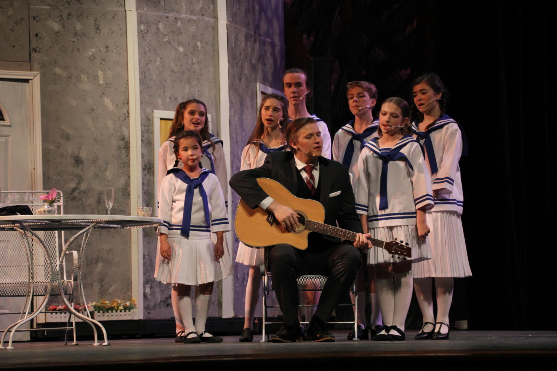 John Paul Kinney and his fellow actors sing