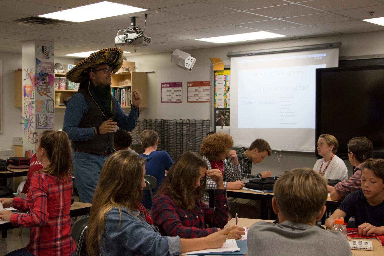 Senior Luna teaching his Spanish class in a basement art classroom.