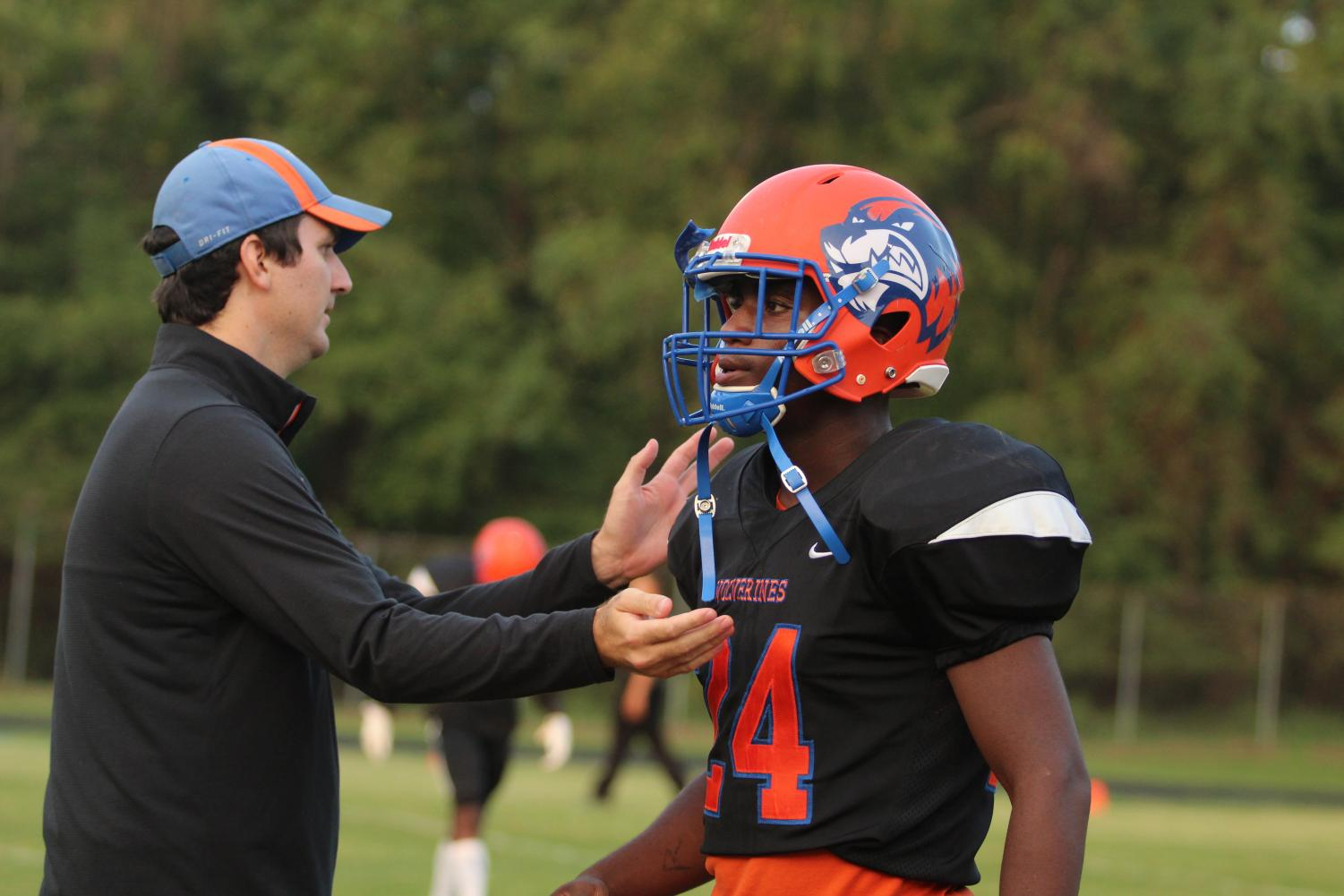 Coach Maxwell Bero talks to sophomore Baebaa Sayeh during a game.  Coaches and athletes alike confirmed that hazing is not tolerated at Watkins Mill.