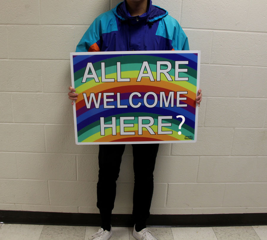 South is often advertised as a very diverse school, like these 'All are welcome here' signs, but we do not necessarily go beyond the statistics and analyze how to bridge across our differences and divisions. Even though this sign may advise that South is an inclusive school it can also been seen as using diversity as a promotion scheme.