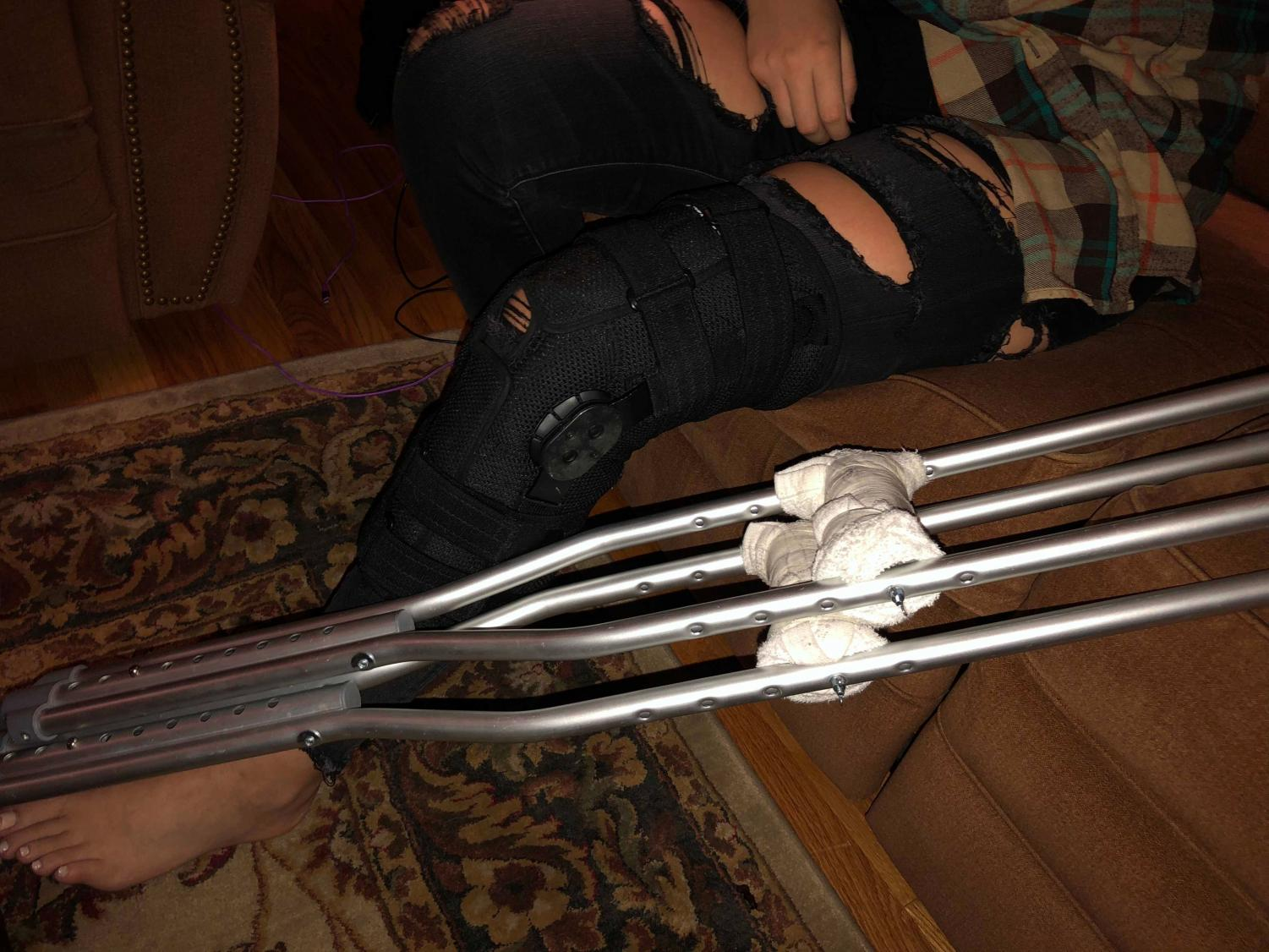 Tool's knee brace and crutches.