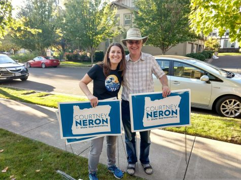 Courtney Neron distributes her lawn signs with a supporter, John Vandenberg of Sherwood, who helped fund lawn signs.