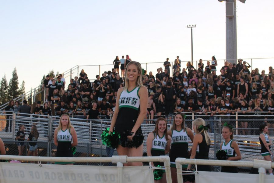 Senior+Faye+Miller+cheering+on+the+sideline+of+a+GBHS+varsity+football+game