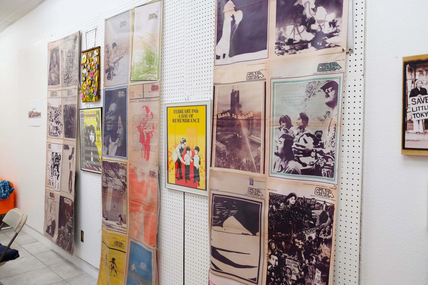 The walls of the room, covered with colorful posters.