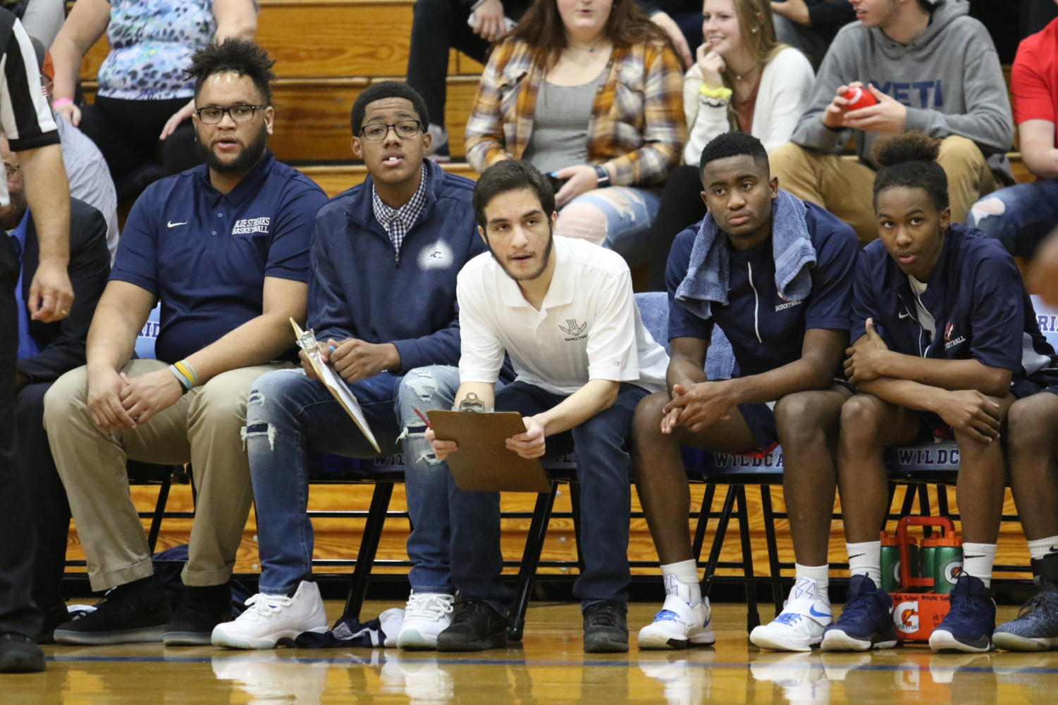 Senior Pana Muhamad (middle) watches the Streaks trail to John Handley. The Streaks lost 51-44.