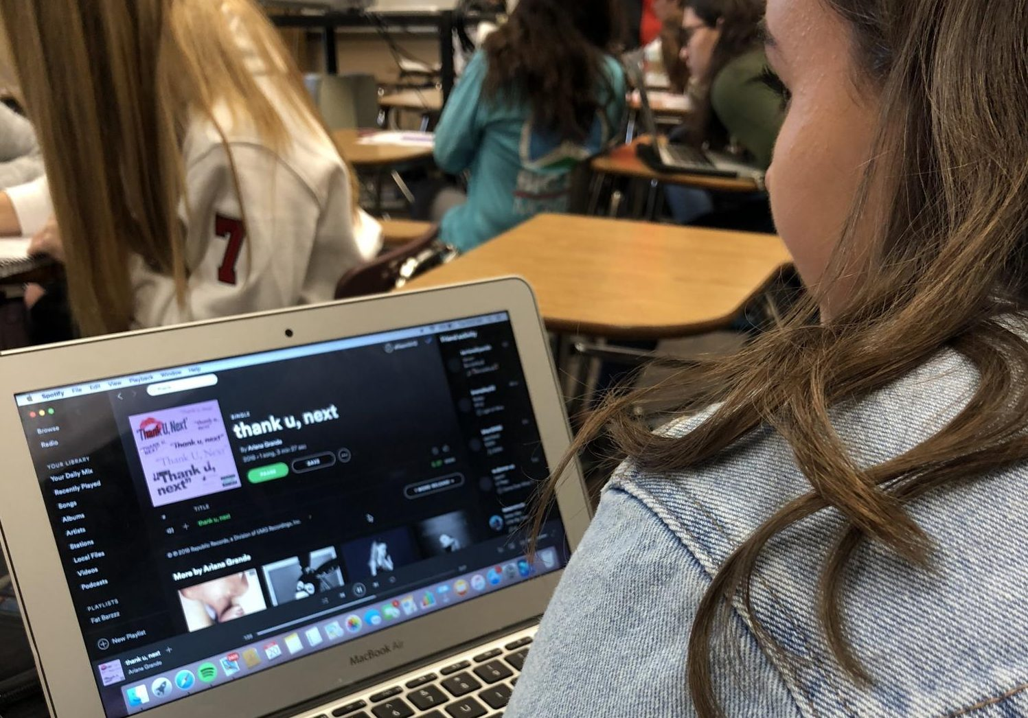 Junior Allie Smith listens to Grande's new song. It has been at the number one spot of the Top 100 Billboard Charts for two consecutive weeks.
