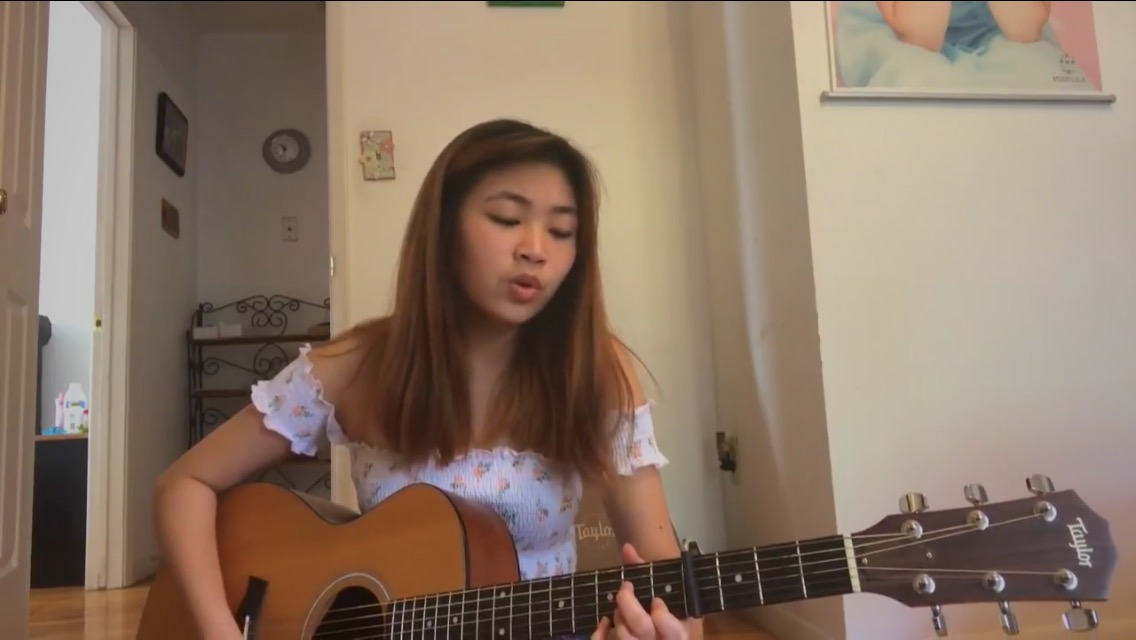 "Debuting her song ""You and Me,"" junior Charlize Chiu plays the guitar for her first live recording on Youtube. Chiu spent almost three months working on additional verses and instrumental parts. ""The most challenging aspect of running social media accounts is finding ways to stay motivated and please everyone on each platform, including myself,"" Chiu said. ""Sometimes people don't like the same things as I do, and that makes things hard."""