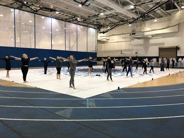 Bringing friendship into a performance: winter guard