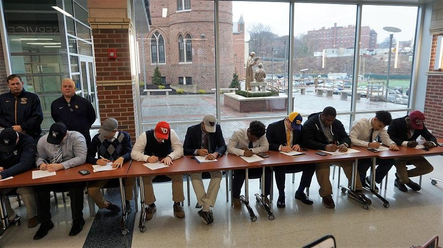 Class of '18 football players during National Signing Day