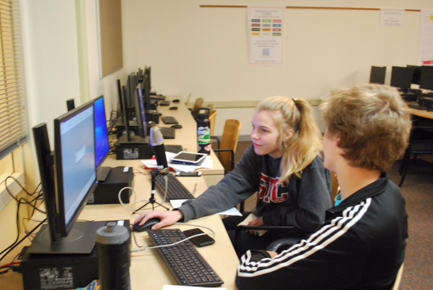 Faith and Media students Lenora Mathis and Jason Nasser-Marsh working on their most recent podcast, discussing the novel
