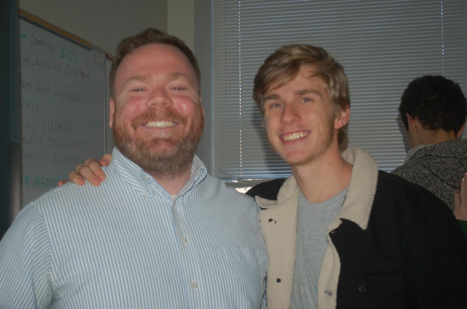 TEACHING FOR JOY: Teacher satisfaction is of utmost importance at school. Psychology teacher Andrew Copeland poses with senior Jacob Greenhill.