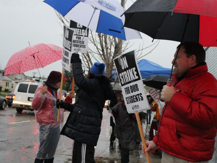 Teachers+and+counselors+from+Daniel+Pearl+Magnet+High+School+waved+up+signs+about+being+on+strike%2C+shouted+out+chants+and+received+honks+from+cars+as+they+continued+to+picket+on+Jan.+14+