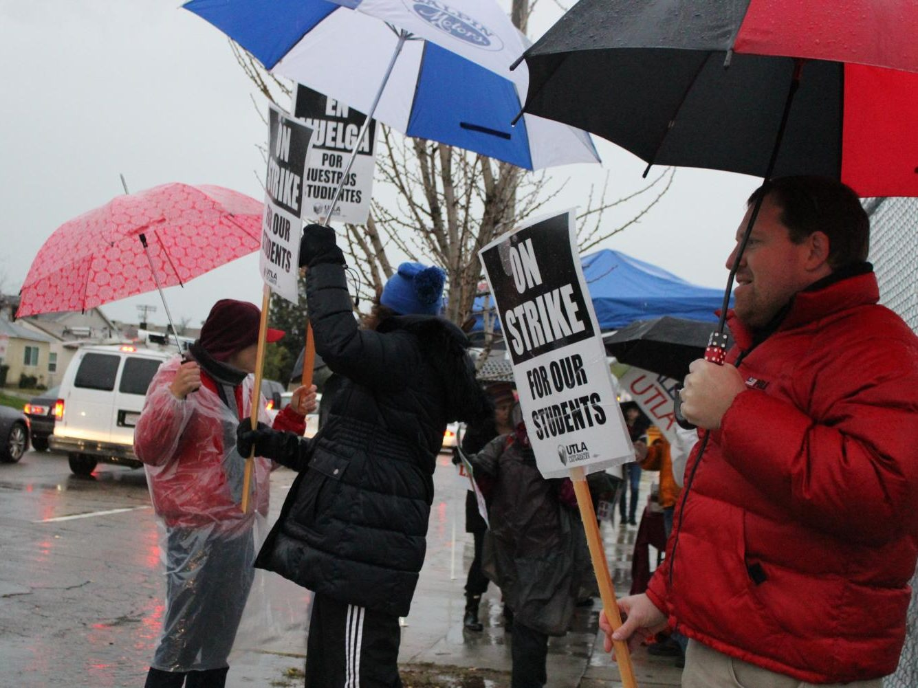 Teachers and counselors from Daniel Pearl Magnet High School waved up signs about being on strike, shouted out chants and received honks from cars as they continued to picket on Jan. 14