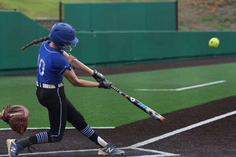 Eye+on+the+ball.+Makenna+swings+the+bat+with+concentration%2C+aiming+to+make+an+offensive+play.+Known+for+her+offensive+power%2C+Makenna+is+seen+as+a+threat+to+opposing+teams.+%22Hitting+is+another+one+of+my+strengths%2C%22+comments+Makenna%2C+%22and+I+am+a+very+heavy+thinker+when+it+comes+to+the+game%22.++