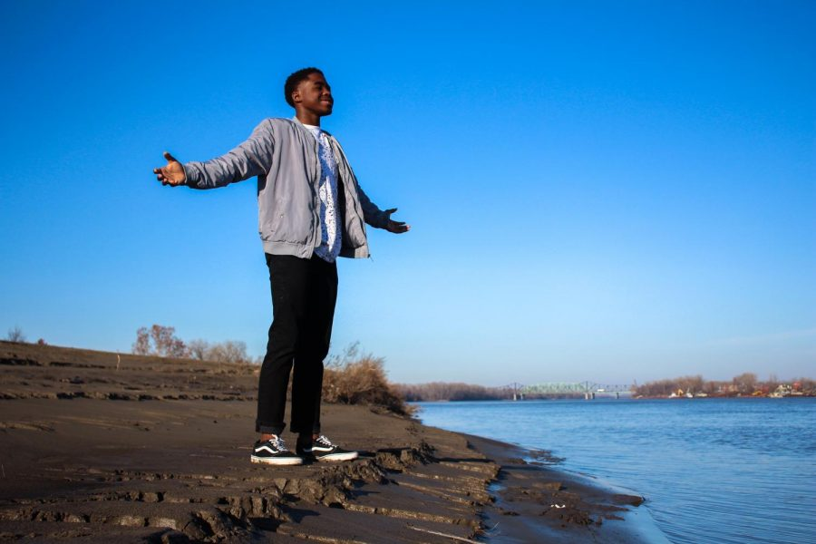 Sophomore AZ Anderson stands by the Mississippi River with his arms spread apart. Anderson was taught as a kid that he had to be independent, and he learned that lesson through many difficult experiences. Because of these trials, Anderson now lives with his grandparents, and he has started to live a more normal life.
