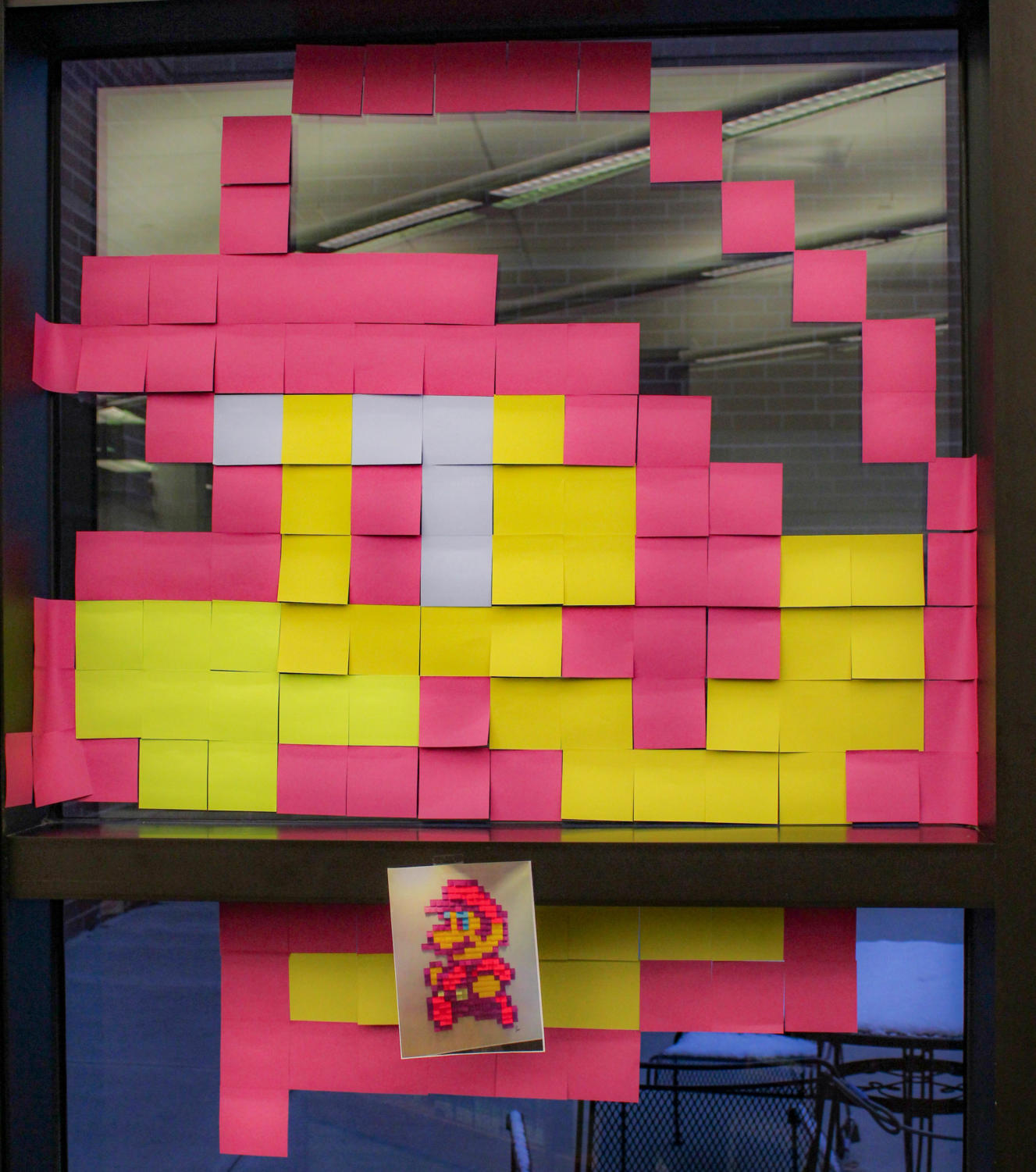 A pixel picture of Mario put together with post-it notes by Jordin Garey.
